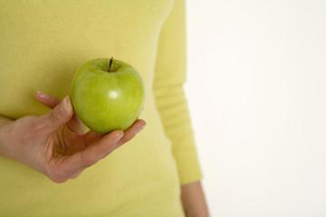 Junge Frau mit Apfel, Nahaufnahme