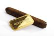 Goldbarren und Zigarre