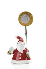 Weihnachtsmann oder Nikolaus hält Euro