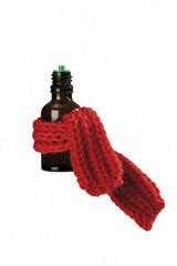 Medizinfläschchen in Schal gewickelt