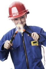Junge mit elektrischem Gerät