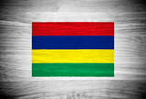 Mauritius flag on wood texture