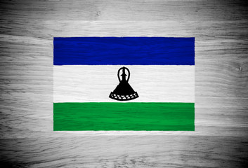 Lesotho flag on wood texture