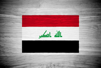 Iraq flag on wood texture