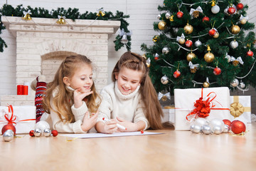 Two little girls writes letter to Santa