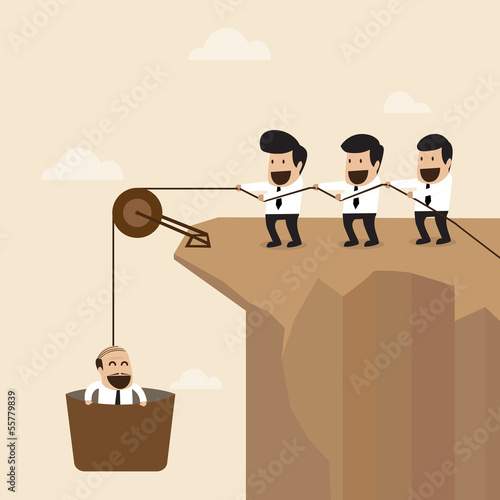 Teamwork concept : Businesspeople help to pull another from bott