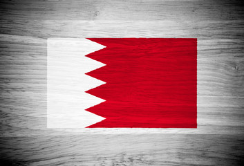Bahrain flag on wood texture