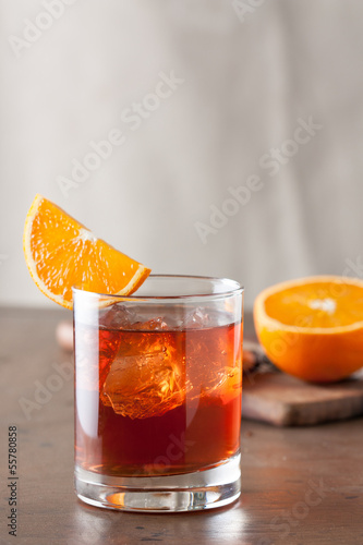 Classic negroni cocktail on wooden table