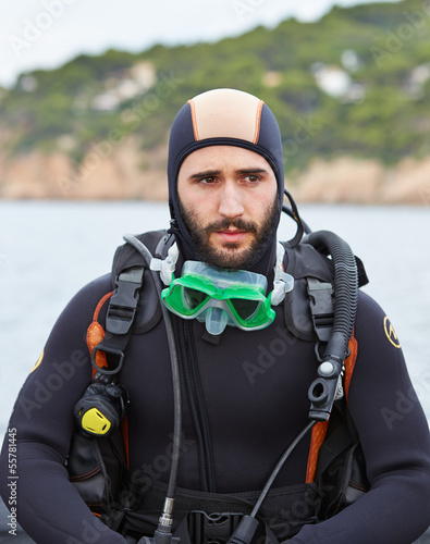 Young man getting ready for scuba diving