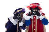 Zwarte Piet and his co-worker are taking photographs