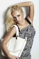 fashion beautiful blond woman with handbag. shopping
