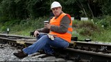 Worker with a coffee on the rail episode 5
