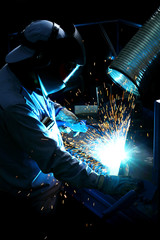 Welder in factory, work