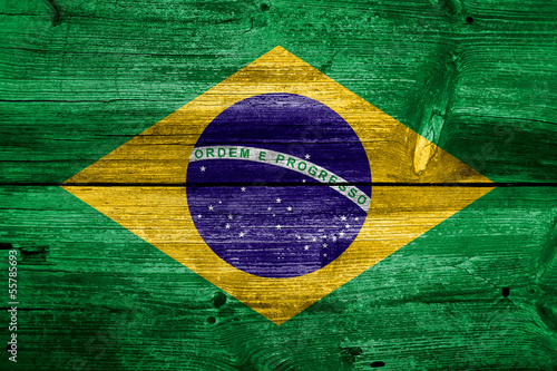 Flag of Brazil painted on grungy wood plank background