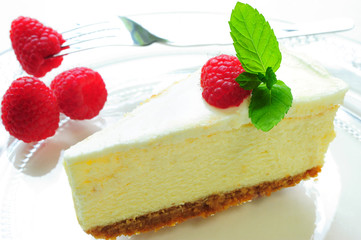 A Piece of Cheesecake with Raspberries