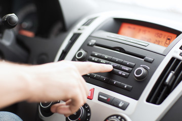 man using car audio stereo system