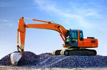 Big excavator on new construction site