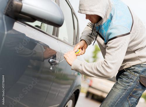 thief breaking the car lock