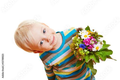 canvas print picture Lächelndes Kind mit Blumenstrauß