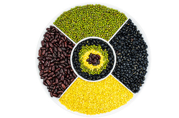 Collection of various beans on a round white plate
