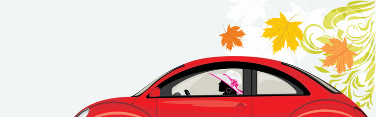 Driving woman a red car on the background with maple leaves