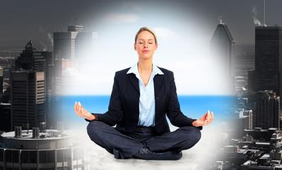 Business woman doing yoga.