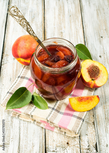 peach jam in a glass jar
