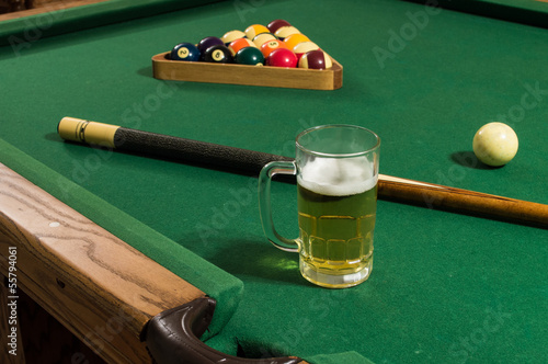glass of beer pool billiards cue and table