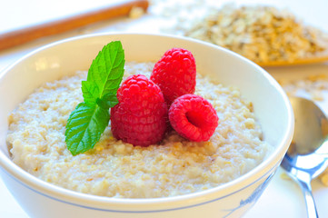 Oatmeal and Raspberries in a White Bowl