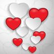 бумажные и красные сердца на сером фоне