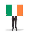 Smiling businessman holding a big card, flag of Ireland