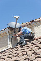 Satellite Installer on Roof 3.