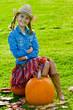 Harvest of pumpkins - girl and large pumpkin