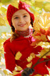 Autumn fun - girl playing in autumn leaves
