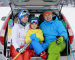 Winter - family with ski equipment ready for travel