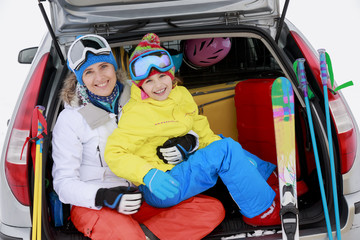 Winter, family with ski equipment ready for travel