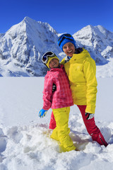 Ski, winter, snow, sun and fun - family enjoying winter