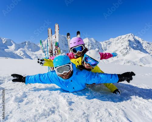 Ski, snow, sun and fun - family enjoying winter
