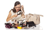 Angry girl searches inside of her bag by magnifying glass
