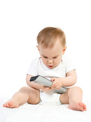 baby with remote control on a white background