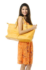 Fashion model with big bag. Isolated