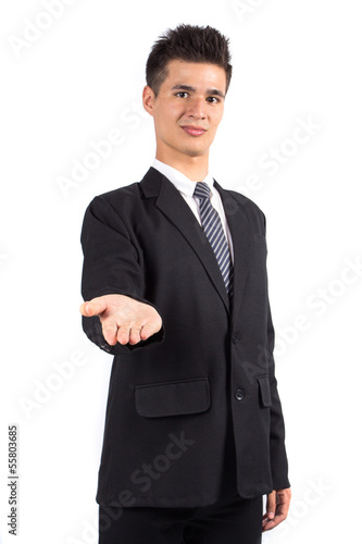 Young business man holding hand presenting a product