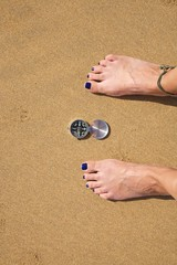 woman feet with silver compass