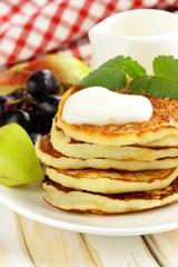 homemade pancakes with fruit and yogurt - healthy breakfast