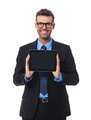 Businessman presenting something on digital tablet