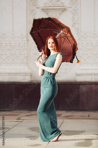 Portrait of beautiful red-haired young woman