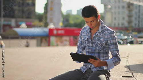 Inspiring information, male browsing tablet pc, getting news