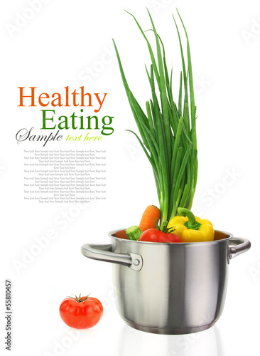 Colorful vegetables in a stainless steel cooking pot