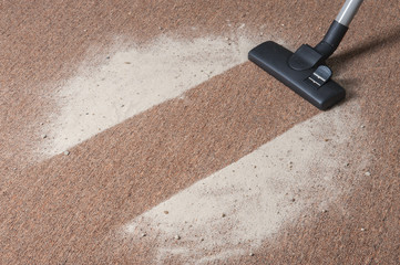 Vacuum cleaning dust on a floor
