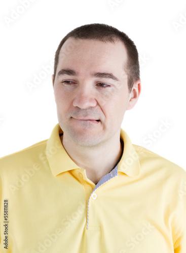 man bit his lip and looks away